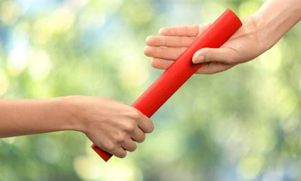 Teaching young athletes how to pass the relay baton